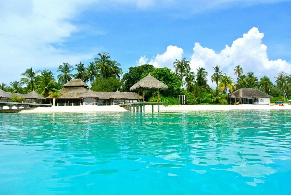 maldives beach and huts water